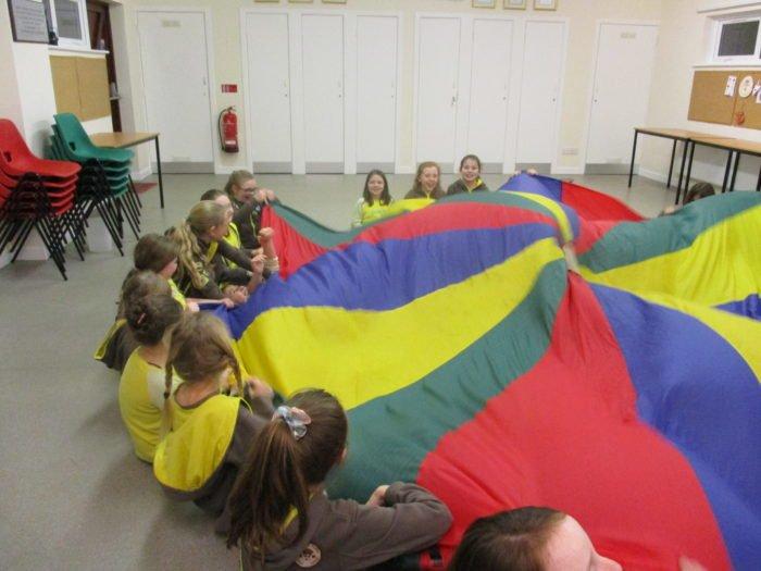 Brownies playing parachute games